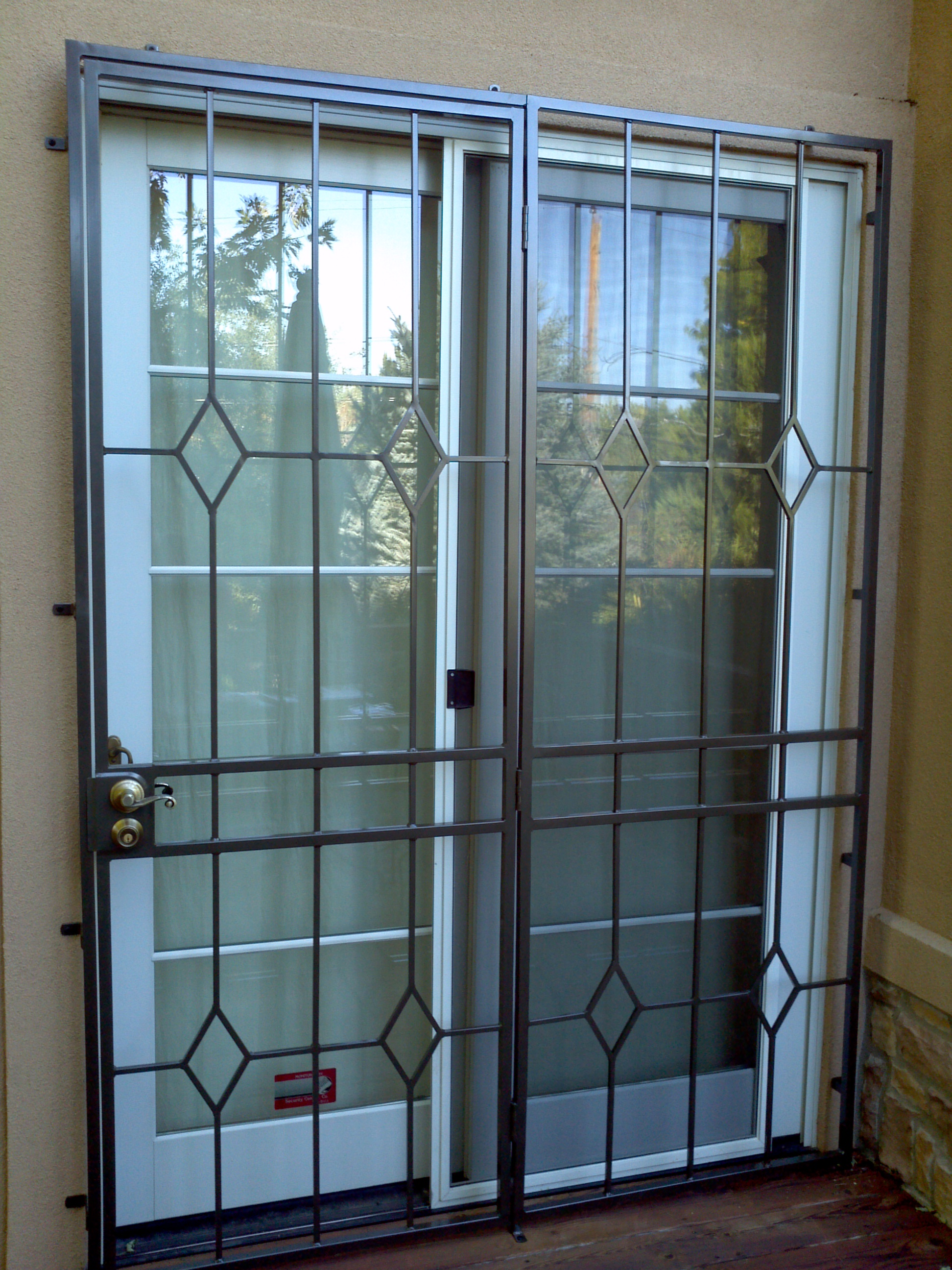 nucleus storm door wrought elegance tag screen doors rod iron home security